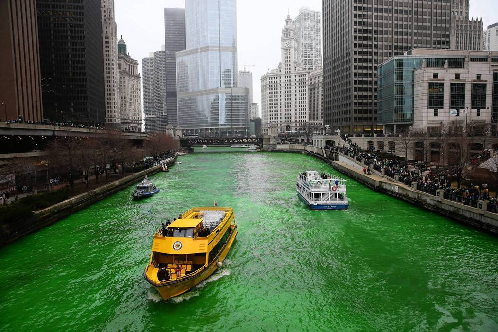"The dyeing of the Chicago River began at about 10 a.m. as thousands ""ooohed"" in the frigid temperatures as a boat left a trail of lime green dye in the water in downtown Chicago on March 16, 2013. (Brian Cassella, Chicago Tribune)....OUTSIDE TRIBUNE CO.- NO MAGS, NO SALES, NO INTERNET, NO TV, CHICAGO OUT, NO DIGITAL MANIPULATION...B582783487Z.1"